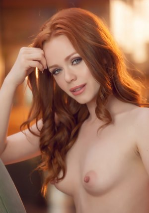 Sexy redhead Ella Hughes pets her pussy after removing sheer lingerie