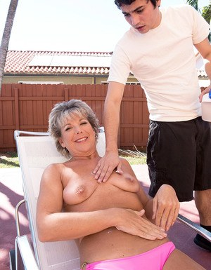 Topless mature woman Constance Joy seduces the young deck boy