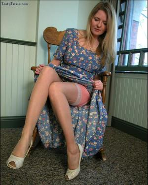 Mature lady Tasty Trixie hitches up her long dress before removing pink undies