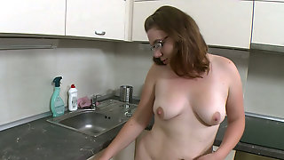 Chubby Dark Haired Chick In Glasses Fucks Her Kitty With Fake Corn At Kitchen