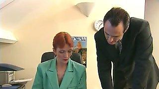 Redheaded Older Secretary Sucks Bosss Cock At Her Desk