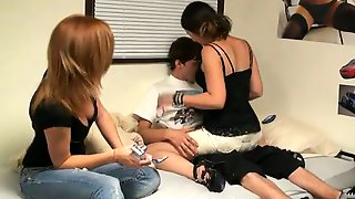 Students Having Fun In A Dorm