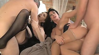 Two Brunette Milfs Get Fucked By Two Horny Dudes In The Living Room