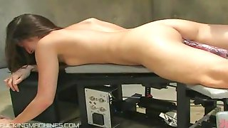 Two Dildos Coming From A Fucking Machine Bang This Babe