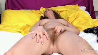 Pretty Mother In Her Bed Playing With Her Hairy Cunt