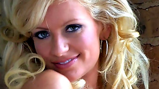 Glamorous Blonde In Sensual Striptease