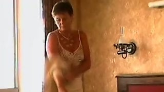 Short Haired Bronze Skin Mature Lady Still Wants Pleasures On The Bed