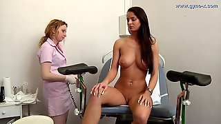 Hot-Blooded Leggy Brunette Comes To Female Gyno Doctor
