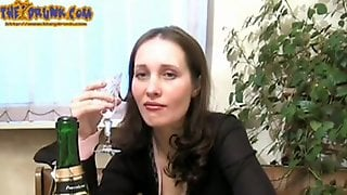 Mature Brunette Drinks Alone And Fills Pussy With Bottle