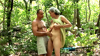 This Lewd Granny Is Sucking A Muscular Mans Dick In The Woods