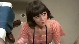 Short-Haired Retro Brunette Plays With Two Humongous Dicks