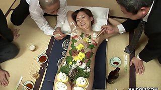 Japanese Business Men Eat Food Off A Beautiful Girl