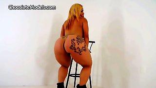 Inked Hooker Enjoys Shaking Her Giant Ass On Camera