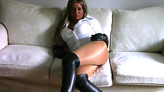 Blonde In Leather Boots And Leather Gloves