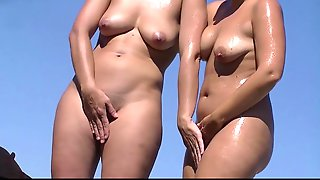 Nice Round Bums Girls Getting Tanned At Nude Beach - Porn Babe