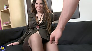My wife is naked and only has nylon lacy stockings on her feet. She knows all about my foot fetish and gives me gentle footjob to make me cum.