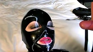 Slut In Latex Hood Sucking Two Men