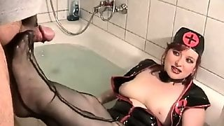 Stacked Brunette In Sexy Lingerie Gives A Sensual Footjob