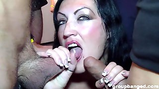 Mature Brunette In A Leather Dress Takes Cum From Two Guys