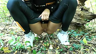 Hot Girl Peeing In Public While Walking In The Forest.