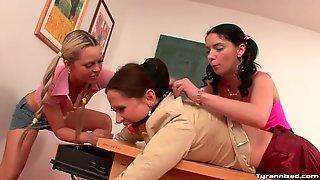 schoolgirl bent over desk