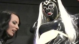 Rubber Sissy Maid Serving Mistress