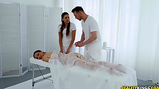 During The Massage Izzy Lush Gets Her Pussy Pleased By Her Masseur