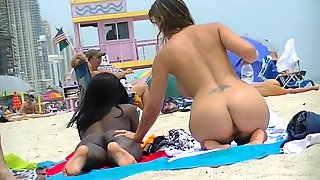 EXHIBITIONIST WIFE #100- HEATHER TAKES HER HUBBY HER GIRLFRIEND TO THE NUDE BEACH! GOOD VOYEUR BAD VOYEUR!!!
