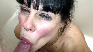 Facial Closeup Swallows A Golden Drink