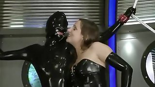 2 Dominatrix, 1 Rubber Slave