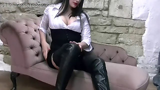 Cool Assistant Babe Leisurely Pulls On Her Leather Thigh Boots Over Her Nylons