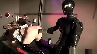 Slave Gets Punished By Rubber Mistress