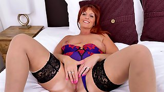 Redhead Momma Beau Diamonds Plays With Vibrator In Bed