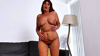 Slightly Chubby Redhead MILF In High Heels Masturbates On The Couch