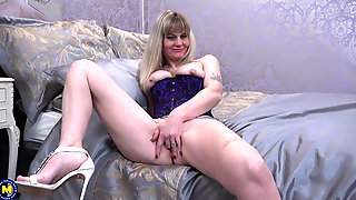 Mature Mom In Corset Fucks Her Pussy