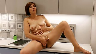 Short Haired GILF With Small Tits Masturbates In The Kitchen