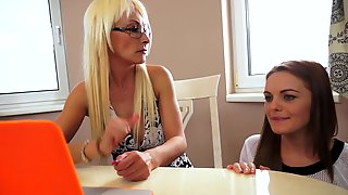 Two Hot Women Are Fucking On The Table In The Erotic Video