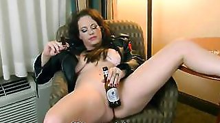 Sherry Stunns Smokes A Cigar And Inserts Bottle In Her Pussy