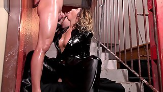 Chick In Leather Gets Oiled Up For Sex.
