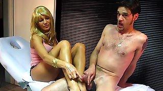 MILF Jerks Off Man In Condom