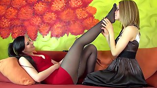 Sexy Domina Makes Her Blonde Female Slave Sniff Her Feet In Nylon Stockings