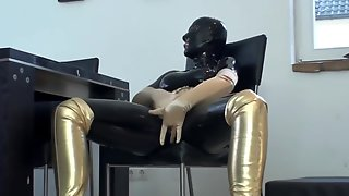 Big Tits Girl In Black Latex Catsuit + Mask + Gloves Piss In Golden Boots