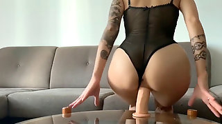 Marvelous Tattooed Chick Dildo Riding Until She Sprays
