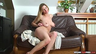 Hot Babe Spreads Her Legs On The Couch To Caress Her Tight Wet Pussy.
