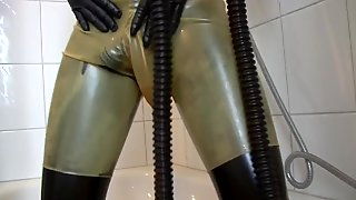 Young Latex Fetish Girl Fully Rubberized With Pisspants And Gasmask
