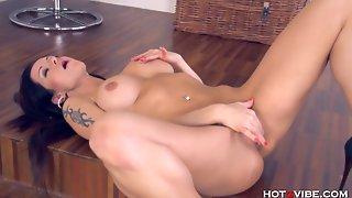 Busty Brunette Tickles Her Clit
