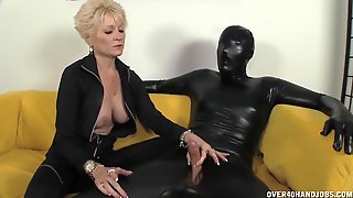 Mischievous Grandma Is Dressed In Ebony Clothes While Providing A Hj To Her Marionette In Spandex