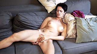 Short-haired Housewife Plays With Her Pussy On The Couch