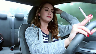 Youthful Brunette Smoking VS 120 In Car