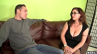 Voluptuous Brunette Is Using Her Massive Milk Jugs To Give A Hard- On To A Guy